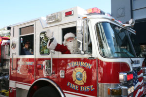 Santa arrives by Fire Truck during the Tiburon Holiday of Lights Festival.